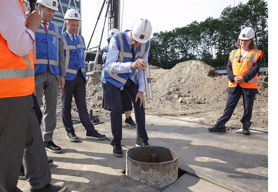 Laying foundation of new building in Amsterdam Zuidas